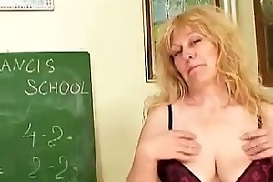 older blond teacher with huge bumpers inserting