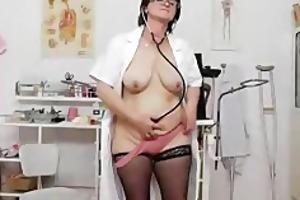 brunette hair practical nurse examining her bawdy