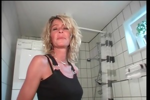 georgous golden-haired bangs herself on the