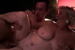 breasty obese grandma enjoys sex with a lad
