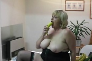 obese aged housewife inserts banana in her pussy