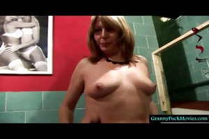 hot granny in fishnet nylons pleases herself