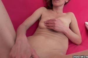 slim and aged homemaker masturbates with sex tool