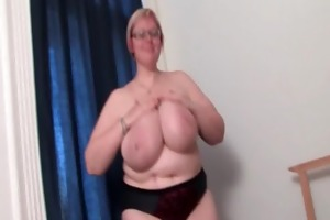 aged big beautiful woman in glasses works her