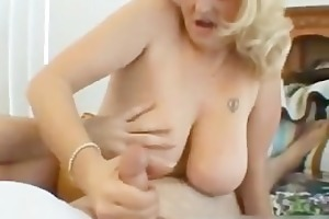 naughty mommy shows her juggs and sucks penis